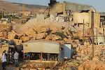 LEBANON Deir el Ahmad, a maronite christian village in Beqaa valley, syrian refugee camp / LIBANON Deir el Ahmad, ein christlich maronitisches Dorf in der Bekaa Ebene, Camp fuer syrische Fluechtlinge, Huette von Soumaya Alkhatib, die Mutter des Jungen Ahmad, vor einer Steinfabrik