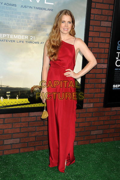 "Amy Adams.""Trouble With The Curve"" Los Angeles Premiere held at the Regency Village Theatre, Westwood, California, USA..September 19th, 2012.full length dress red gold bag purse hand on hip.CAP/ADM/BP.©Byron Purvis/AdMedia/Capital Pictures."