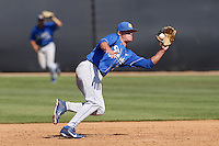 Ryan Clark #13 of the UC Santa Barbara Gauchos fields a line drive during a game against the Cal State Northridge Matadors at Matador Field on May 11, 2013 in Northridge, California. UC Santa Barbara defeated Cal State Northridge, 6-2. (Larry Goren/Four Seam Images)