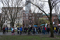 """A group from Boston University marches along the Commonwealth Avenue Mall in Boston, Massachusetts, during the March for Science demonstration on Sat., April 22, 2017. The group was chanting, """"What do we want? Science! When do we want it? After peer review!"""""""