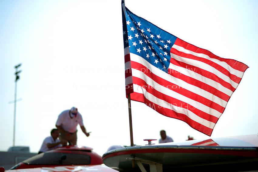 The American Flag flies in the pits.