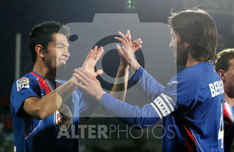 Getafe's Miku and David Belenguer celebrate during La Liga match. March 11, 2010. (ALTERPHOTOS/Alvaro Hernandez)