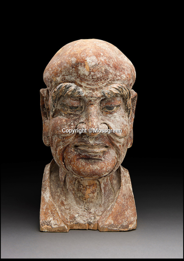 BNPS.co.uk (01202 558833)<br /> Pic: Mossgreen/BNPS<br /> <br /> Ornamental Buddhist monument that the note was found in.<br /> <br /> Not funny money - An ancient Chinese bank note with the grim warning 'those who use counterfeit banknote will be beheaded, the whistle-blower will be rewarded 250 Liang silvers plus all the properties of the criminal.' has been discovered in an old buddhist statue.<br /> <br /> A rare 700-year-old Chinese banknote dating from the Ming Dynasty has been discovered hidden inside the head of an ornamental Buddhist monument. <br /> <br /> The crumpled A4-sized piece of paper was found in a 13th century wooden sculpture of a Luohan - a name given to those who have achieved enlightenment - purely by chance at an auction house in Australia. <br /> <br /> Specialists were inspecting the carving for any damage so that it could be valued before going under the hammer when they uncovered the folded currency concealed in the head cavity.<br /> <br /> The Luohan sculpture and the banknote will be be sold together next month by Mossgreen auction house in Australia with a combined estimate of £37,000. The banknote on its own would be expected to achieve £3,000.