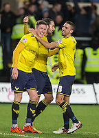 John Lundstram (left) of Oxford United celebrates victory with Danny Hylton of Oxford United & Liam Sercombe (right) of Oxford United during the Johnstone's Paint Trophy Southern Final 2nd Leg match between Oxford United and Millwall at the Kassam Stadium, Oxford, England on 2 February 2016. Photo by Andy Rowland / PRiME Media Images.