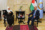 Former Palestinian Prime Minister, Rami Hamdallah, meets with the family of the prisoner Maher Younes, in the West Bank city of Ramallah, on March 11, 2019. Photo by Prime Minister Office