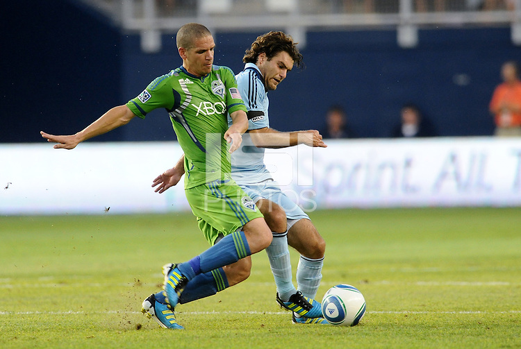 Osvaldo Alonso (6) midfielder Seattle Sounders and Graham Zusi (8) midfielder Sporting KC fight for the ball in midfield... Sporting Kansas City were defeated 1-2 by Seattle Sounders at LIVESTRONG Sporting Park, Kansas City, Kansas.