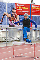 Krasnodar, Russia, 16/03/2009..World champion heptathlete Tatyana Chernova practicing hurdles in front of a poster of herself at the stadium in her home city of Krasnodar. Chernova, who won bronze in the Beijing Olympic Games, is tipped for gold in the forthcoming London Olympics.