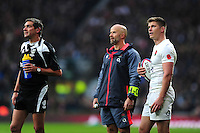 Referee Jerome Garces and Owen Farrell of England watch a replay on the big screen. Old Mutual Wealth Series International match between England and South Africa on November 12, 2016 at Twickenham Stadium in London, England. Photo by: Patrick Khachfe / Onside Images