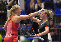Rotterdam, Netherlands, December 20, 2015,  Topsport Centrum, Lotto NK Tennis, Final womans single Kiki Bertens (L) congratulates Richel Hogenkamp with her win and embrace.<br /> Photo: Tennisimages/Henk Koster