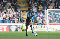 Sido Jombati of Wycombe Wanderers in action during the Sky Bet League 2 match between Wycombe Wanderers and Plymouth Argyle at Adams Park, High Wycombe, England on 12 September 2015. Photo by Andy Rowland.