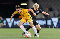June 7, 2016: LISA DE VANNA (11) of Australia and BETSY HASSETT (12) of New Zealand fight for the ball during an international friendly match between the Australian Matildas and the New Zealand Football Ferns as part of the teams' preparation for the Rio Olympic Games at Etihad Stadium, Melbourne. Photo Sydney Low
