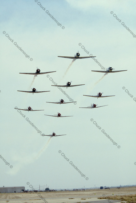 Stock Photo of North American AT-6 Fighter Trainer WW2 airplanes in Flight Formation