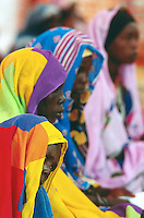 Sudan. West Darfur. Kerenek. The non-governmental organization (ngo) Médecins sans Frontières (MSF) Switzerland runs a medical program. A group of women, wearing a veil on their heads, wait for a medical consultation with a doctor. © 2004 Didier Ruef