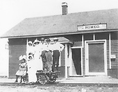 D&amp;RG Romeo depot with seven people posing on a speeder car.  The depot is painted red.<br /> D&amp;RG  Romeo, CO  Taken by Joyce, W. D. - ca. 1910-1915