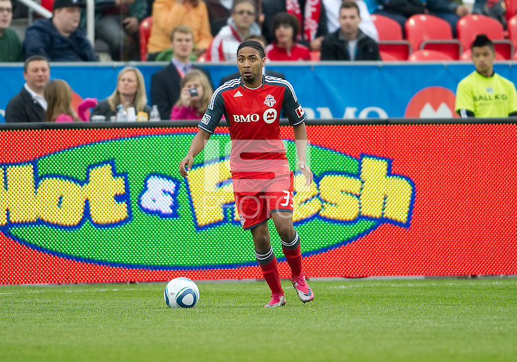 Toronto FC forward Javier Martina #33 in action during an MLS game between Sporting Kansas City and the Toronto FC at BMO Field in Toronto on June 4, 2011..The game ended in a 0-0 draw...