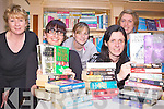 TURN THE PAGE: Staff at the Buds Family Resource Centre in Ballyduff with a selection of newly acquired books which are available from their library, front l-r: Breda Canty, Bernadette Martin. Back l-r: Noreen O'Callaghan, Katie McCabe, Karina Griffin.