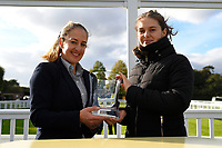 A connection of Ayrad receives their trophy for winning The Weatherby's General Stud Book Online Handicap Stakes     during Afternoon Racing at Salisbury Racecourse on 4th October 2017