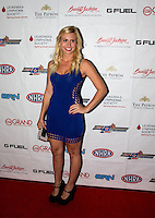 Aug. 29, 2013; Avon, IN, USA: NHRA NHRA funny car driver Courtney Force on the red carpet prior to the premiere of Snake & Mongoo$e at the Regal Shiloh Crossing Stadium 18. Mandatory Credit: Mark J. Rebilas-