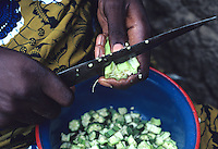 Woman cutting okra for dinner