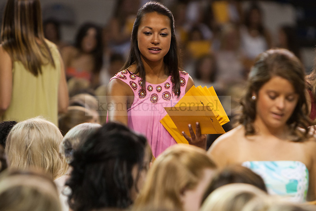 Katie Donnowitz hands out bids to new sorority members during sorority bid day in Lexington, Ky. on Friday, August 21, 2015. Photo by Adam Pennavaria | Staff