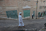 A Muslim man walks in Bethlehem, West Bank.