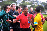 Referee Nortbert Hauata (centre) calms things down after sending off Jelewed Pierrott (right) during the Oceania Football Championship semifinal (second leg) football match between Team Wellington and AS Magenta at David Farrington Park in Wellington, New Zealand on Sunday, 16 April 2017. Photo: Dave Lintott / lintottphoto.co.nz