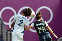 Glasgow, Scotland - July 25, 2012: Abby Wambach of the USA goes up against Wendie Renard of France during the US women's team's 4-2 victory over France.