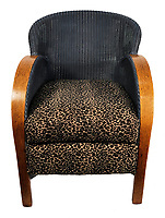 BNPS.co.uk (01202 558833)<br /> Pic: Tracks/BNPS<br /> <br /> A chair that featured on the cover of the legendary Oasis album Definitely Maybe has emerged for sale for £12,500.<br /> <br /> The leopard print wicker seat belonged to guitarist Paul 'Bonehead' Arthurs whose front room was the scene for the iconic shot.<br /> <br /> The location was chosen as Bonehead had the nicest flat of all the band in Didsbury, South Manchester.