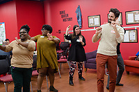 Left to right: Office Coordinator Brittney Brown, her fiancé Raquiiba Williams, Counseling and Psychological Services intern Dani Rosenkratz and CSGD director Nick Antonicci,(ALL CQ) dance at a WorkOUT Potluck at the Center for Sexual and Gender Diversity at Duke University in Durham, North Carolina Monday, November 12, 2018. (Justin Cook)