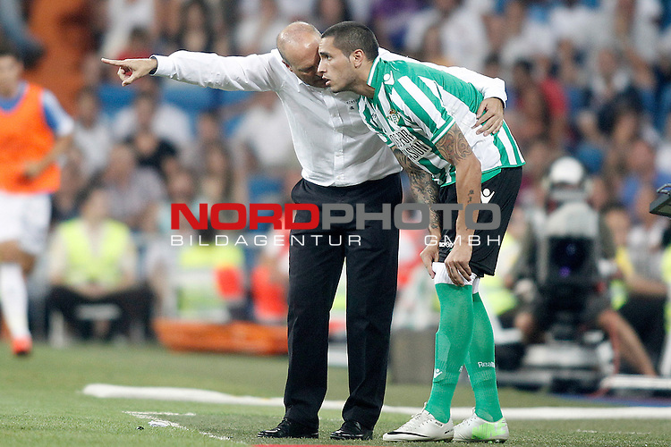 Betis' coach Pepe Mel with Braian Rodriguez during La Liga match.August 18,2013. Foto © nph / Acero)