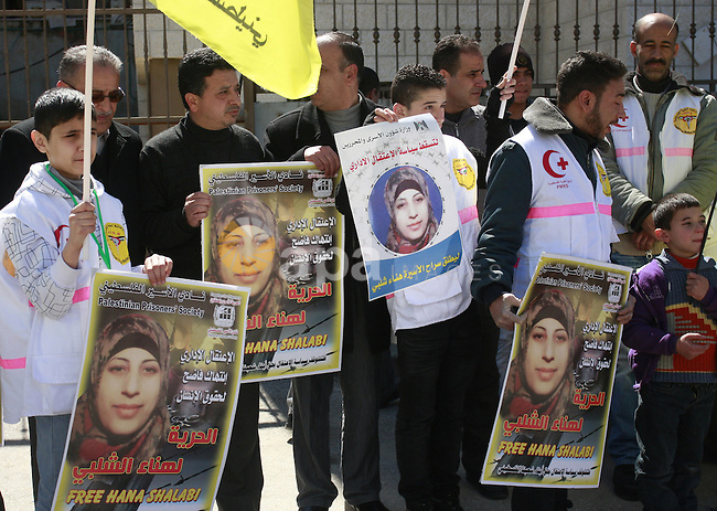 Palestinians take part in a protest in solidarity with Hana Shalabi, a Palestinian prisoner jailed in Israel and who has been on hunger strike for 21 days, in the West Bank in Nablus, Wednesday, March 7, 2012. Palestinian sources said Shalabi is protesting against the Israeli administrative detention, a law imposed against Palestinian prisoners in which the prisoner can be detained for months without charge or trial.  Photo by Wagdi Eshtayah