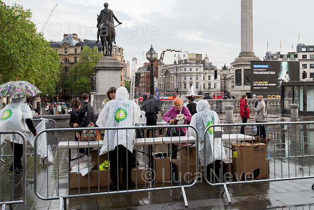 London, 18/05/2016. Today, Art Not Oil held a flashmob in Trafalgar Square while in the famous London's landmark was shown the Royal Opera House new Frankenstein ballet on a BP-sponsored big screen (&lt;&lt;British Petroleum, is one of the world's seven &quot;supermajor&quot; oil and gas companies [&hellip;]&gt;&gt; - Source Wikipedia.org). From the organisers Facebook page: &lt;&lt;[&hellip;] We're sick of oil companies use of arts sponsorship to hide their monstrous behaviour, as they trample over the rights of communities and local environments around the world. [...] It's the world premiere of Liam Scarlett's new full-length ballet, inspired by Mary Shelley's Gothic masterpiece, [&hellip;]&gt;&gt;.<br /> <br /> For more information please click here: https://www.facebook.com/events/589236824576256/ &amp; http://www.artnotoil.org.uk/ &amp; http://bp-or-not-bp.org/