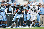 23 November 2013: UNC's Quinshad Davis (14) is chased by ODU's Sandy Chapman (18). The University of North Carolina Tar Heels played the Old Dominion University Monarchs at Keenan Stadium in Chapel Hill, NC in a 2013 NCAA Division I Football game. UNC won the game 80-20.