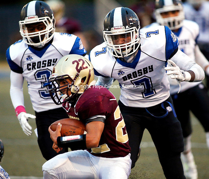 Waterbury, CT- 01 October 2015-100115CM08-  Sacred Heart's Joel Guzman rushes with the ball during their NVL matchup against Crosby in Waterbury on Thursday.   Behind Guzman are Crosby's Kenney Petteway (3) and Alvin Lopes (7).    Christopher Massa Republican-American