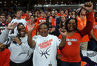 Clemson fans cheer during an ACC basketball game against Virginia Tuesday Jan. 19, 2016, in Charlottesville, Va. ( Photo/Andrew Shurtleff)