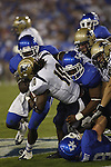 A pack of UK defenders take down an Akron player during the first half of UK's home game against Akron, Saturday, September 17, 2010.  Photo by Brandon Goodwin | Staff