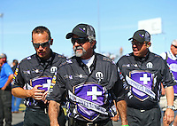 Apr 12, 2015; Las Vegas, NV, USA; NHRA funny car driver Jack Beckman (left) walks with his crew chiefs John Medlen (center) and Jimmy Prock during the Summitracing.com Nationals at The Strip at Las Vegas Motor Speedway. Mandatory Credit: Mark J. Rebilas-