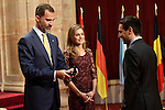 Spain's Crown Prince Felipe (L) and Princess Letizia give a medal to representative of the Max Planck Society for the Advancement of Science Ali Shahmoradi, laureate of the 203 Prince of Asturias Award for  International Cooperation, during an official audience at the Reconquista Hotel in Oviedo, Spain. October 25, 2013..(ALTERPHOTOS/Victor Blanco)