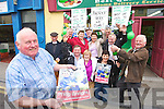 THEY'RE OFF Tony Enright, proprietor of O'Carroll's Fruit & Veg in Tralee, father of local Jockey Philip Enright who rides Preist's Leap in the English Grand National, popping the champagne, outside their shop yesterday. Pictured with Tony are Pat Walsh, Bridie O'Connor and Margaret White. Standing are John Callaghan (dressed as a Priest), Tommy Comerford, Tina Cunningham, Tom O'Mahony, Bridie Roche, Benny Sullivan, Tom O'Brien and Davey Barrett.