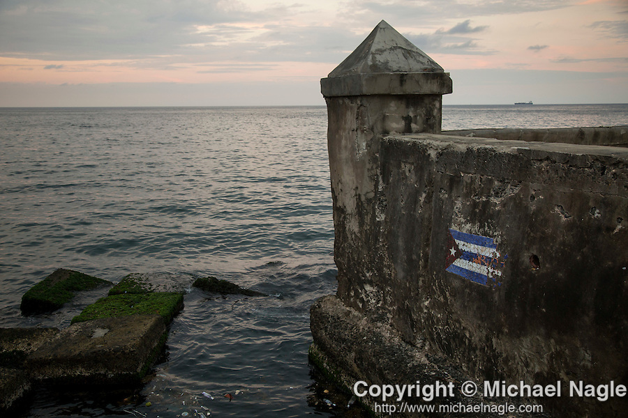 HAVANA, CUBA -- MARCH 24, 2015:   The Cuban flag is painted on the seawall along the Malecon in Havana, Cuba on March 24, 2015. Photograph by Michael Nagle