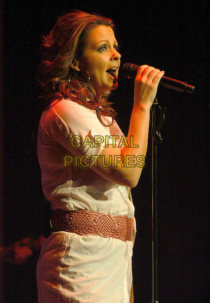 "SARA EVANS.Voted ""One of the Most Beautiful Women in Country Music,"" Sara Evans performs at Chrysler Hall in support of her upcoming ""Greatest Hits"" album, Norfolk, Virginia, USA,15 February 2007..half length live singing on stage concert .CAP/ADM/MK.©Mike Kline/AdMedia/Capital Pictures."