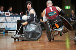 Victoria's Jayden Warn Looks on as Qld's Chris Bond goes up on one wheel during the Gold Medal Match of the  National Wheelchair Rugby Championships 2013 <br />