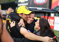 Oct 2, 2016; Mohnton, PA, USA; NHRA pro stock driver Vincent Nobile celebrates with girlfriend after winning the Dodge Nationals at Maple Grove Raceway. Mandatory Credit: Mark J. Rebilas-USA TODAY Sports