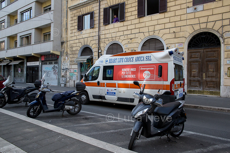 """Viale Flaminio.<br /> <br /> Rome, 12/03/2020. Documenting Rome under the Italian Government lockdown for the Outbreak of the Coronavirus (SARS-CoV-2 - COVID-19) in Italy. On the evening of the 11 March 2020, the Italian Prime Minister, Giuseppe Conte, signed the March 11th Decree Law """"Step 4 Consolidation of 1 single Protection Zone for the entire national territory"""" (1.). The further urgent measures were taken """"in order to counter and contain the spread of the COVID-19 virus"""" on the same day when the WHO (World Health Organization, OMS in Italian) declared the coronavirus COVID-19 as a pandemic (2.).<br /> ISTAT (Italian Institute of Statistics) estimates that in Italy there are 50,724 homeless people. In Rome, around 20,000 people in fragile condition have asked for support. Moreover, there are 40,000 people who live in a state of housing emergency in Rome's municipality.<br /> March 11th Decree Law (1.): «[…] Retail commercial activities are suspended, with the exception of the food and basic necessities activities […] Newsagents, tobacconists, pharmacies and parapharmacies remain open. In any case, the interpersonal safety distance of one meter must be guaranteed. The activities of catering services (including bars, pubs, restaurants, ice cream shops, patisseries) are suspended […] Banking, financial and insurance services as well as the agricultural, livestock and agri-food processing sector, including the supply chains that supply goods and services, are guaranteed, […] The President of the Region can arrange the programming of the service provided by local public transport companies […]».<br /> Updates: on the 12.03.20 (6:00PM) in Italy there 14.955 positive cases; 1,439 patients have recovered; 1,266 died.<br /> <br /> Footnotes & Links:<br /> Info about COVID-19 in Italy: http://bit.do/fzRVu (ITA) - http://bit.do/fzRV5 (ENG)<br /> 1. March 11th Decree Law http://bit.do/fzREX (ITA) - http://bit.do/fzRFz (ENG)<br /> 2. http://bit.do/fzRKm"""