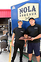 NOLA BBQeaux serves BBQ at the  Westbank Nawlins Flea Market. Sang Phan and Tuan Huynh