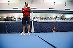 24 MAY 2016:  Oklahoma assistant coach Bobby Reynolds surveys the courts while his team plays in singles play. The Division I Men's Tennis Championship is held at the Michael D. Case Tennis Center on the University of Tulsa campus in Tulsa, OK.  Virginia defeated Oklahoma for the national championship. Shane Bevel/NCAA Photos