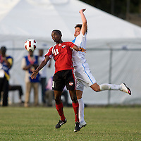 Julio Ortiz (5) of Guatemala stays close to Garvin Samaroo (11) of Trinidad & Tobago  during the group stage of the CONCACAF Men's Under 17 Championship at Jarrett Park in Montego Bay, Jamaica. Trinidad & Tobago defeated Guatemala, 1-0.
