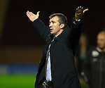Jim Gannon signalls from the Motherwell dugout