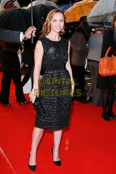 CHRISTINA RICCI .Arriving at the Speed Racer - UK film premiere, Empire Leicester Square,.London, England, April 28th 2008..full length black patterned dress clutch bag shoes raining .CAP/DAR.©Darwin/Capital Pictures