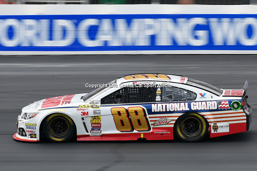 July 13, 2014 - Loudon, New Hampshire, U.S. - Sprint Cup Series driver Dale Earnhardt Jr. (88) heads into turn 4 during the NASCAR Sprint Cup Series Camping World RV 301 race held at the New Hampshire Motor Speedway in Loudon, New Hampshire. Eric Canha/CSM